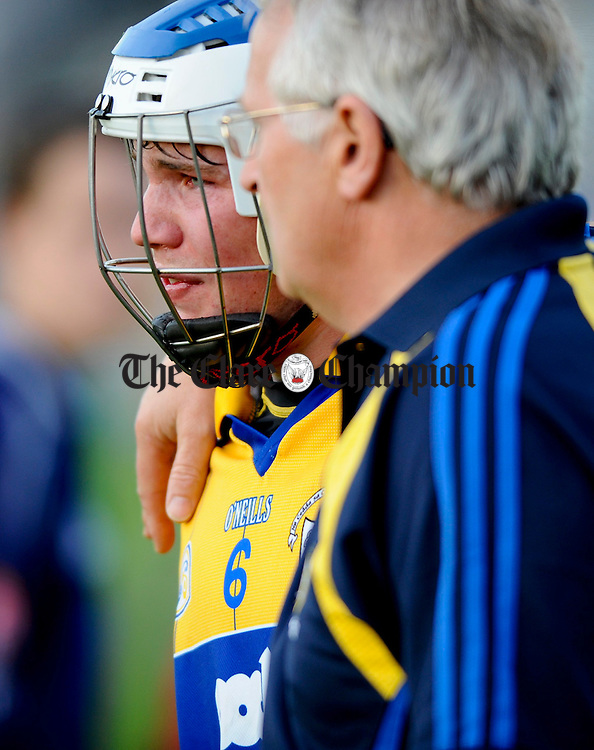 A clearly devastated Aidan Quilligan of Clare is comforted after the Munster U-21 final at Cusack Park. Photograph by John Kelly.