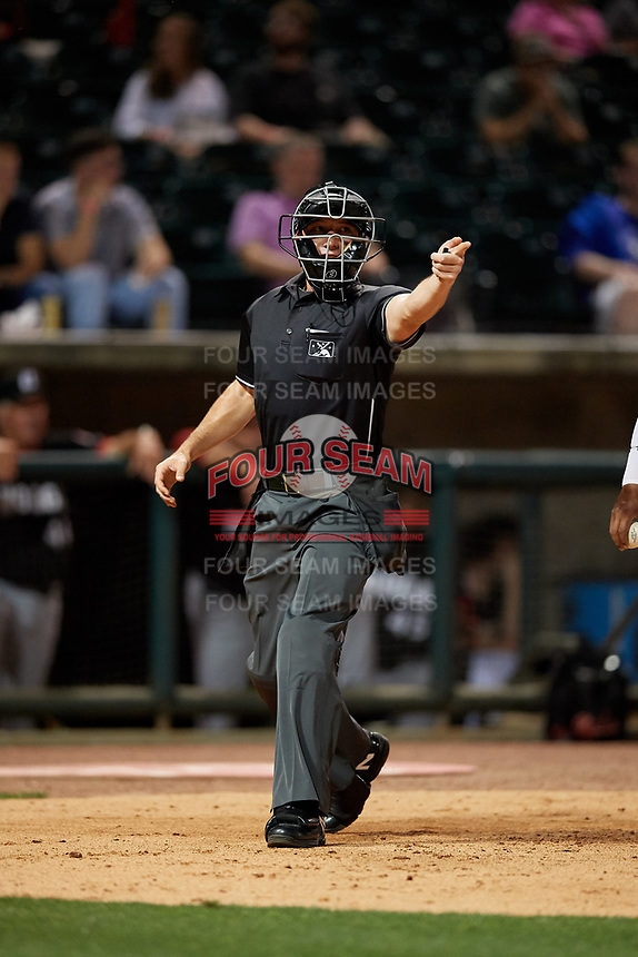 Umpire Matthew Brown asks for help from the first base umpire during a Southern League game between the Chattanooga Lookouts and Birmingham Barons on May 1, 2019 at Regions Field in Birmingham, Alabama.  Chattanooga defeated Birmingham 5-0.  (Mike Janes/Four Seam Images)