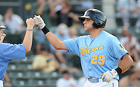 Catcher Vincent DiFazio (29) of the Myrtle Beach Pelicans is congratulated after hitting a home run in a game against the Frederick Keys on August 4, 2012, at TicketReturn.Com Field in Myrtle Beach, South Carolina. Myrtle Beach won, 4-3. (Tom Priddy/Four Seam Images)
