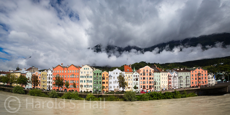 The Old Town section of Innsbruck, Austria is lit by the sun as a passing storm begins to clear.