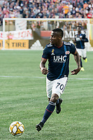 FOXBOROUGH, MA - SEPTEMBER 29: Cristian Penilla #70 of New England Revolution brings the ball forward during a game between New York City FC and New England Revolution at Gillettes Stadium on September 29, 2019 in Foxborough, Massachusetts.