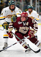 18 October 2009: Boston College Eagle forward Ben Smith, a Senior from Avon, CT, in action against defenseman Patrick Cullity, a Senior from Tewsbury, MA, of the University of Vermont Catamounts at Gutterson Fieldhouse in Burlington, Vermont. The Catamounts defeated the visiting Eagles 4-1. Mandatory Credit: Ed Wolfstein Photo