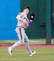 Jack Mitchell (7) of the Northwestern Wildcats catches a ball in left field during a game against the Missouri State Bears at Hammons Field on March 8, 2013 in Springfield, Missouri. (David Welker/Four Seam Images)