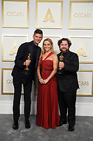 Michael Govier, Reese Witherspoon and Will McCormack pose backstage with the Oscar® for Animated Short Film during the live ABC Telecast of The 93rd Oscars® at Union Station in Los Angeles, CA on Sunday, April 25, 2021.<br /> *Editorial Use Only*<br /> ©A.M.P.A.S.<br /> Image supplied by Capital Pictures