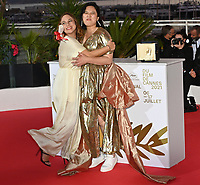 CANNES, FRANCE. July 17, 2021: Tang Yi & Lasmin Tenucci at the photocall for Cannes Awards 2021 at the 74th Festival de Cannes.<br /> Picture: Paul Smith / Featureflash
