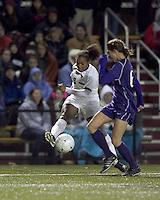 "Boston College forward Natalie Crutchfield (9) crosses the ball as University of Washington midfielder Lindsey Bos (6) defends. In overtime, Boston College defeated University of Washington, 1-0, in NCAA tournament ""Elite 8"" match at Newton Soccer Field, Newton, MA, on November 27, 2010."