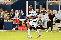 KANSAS CITY, KS - JULY 31: Nicolas Isimat-Mirin #5 Sporting KC with the ball during a game between FC Dallas and Sporting Kansas City at Children's Mercy Park on July 31, 2021 in Kansas City, Kansas.