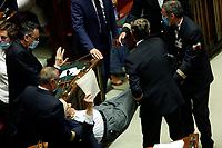 Deputy Vittorio Sgarbi, at the Chamber of Deputies, during the final vote on the Justice Decree, is expelled and brought outside by force by the clerks, after he called the Superior Council of the Judiciary, a Mafia association, and insulted the Vice President of the Chamber and the deputy Giusi Bartolozzi that was talking at the moment. Rome (Italy), June 25th 2020<br /> Vittorio sgarbi viene cacciato dall'Aula della Camera e portato via di forza dai commessi, dopo aver accusato il CSM di essere un'associazione mafiosa e dopo aver insultato le deputata Giusi Bartolozzi e la vice-presidente della Camera Mara Carfagna.<br /> Foto Samantha Zucchi Insidefoto