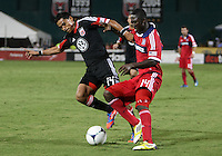 WASHINGTON, DC. - AUGUST 22, 2012:  Andy Najar (14) of DC United tangles with  Patrick Nyarko (14) of the Chicago Fire during an MLS match at RFK Stadium, in Washington DC,  on August 22. United won 4-2.