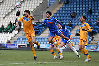 Ryan Sweeney of Mansfield Town and Courtney Senior of Colchester United during Colchester United vs Mansfield Town, Sky Bet EFL League 2 Football at the JobServe Community Stadium on 14th February 2021