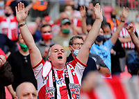 A Brentford fan sings his heart out at Wembley during Brentford vs Swansea City, Sky Bet EFL Championship Play-Off Final Football at Wembley Stadium on 29th May 2021