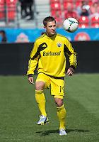 18 May 2013: Columbus Crew midfielder Konrad Warzycha #19 warm-ups during an MLS game between the Columbus Crew and Toronto FC at BMO Field in Toronto, Ontario Canada..The Columbus Crew won 1-0...