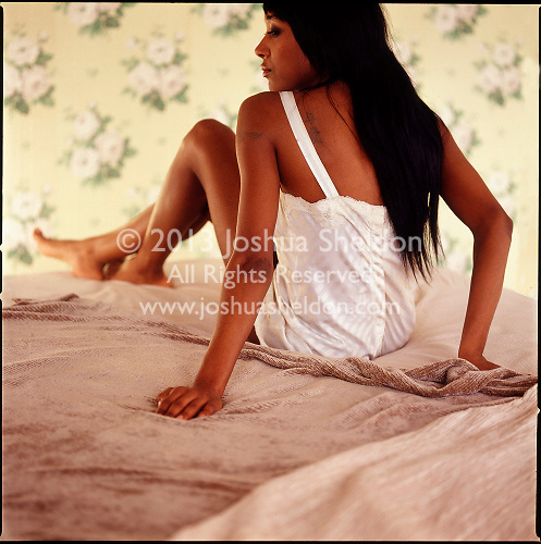 African American woman relaxing on bed