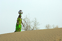 Thar desert, Rajasthan Women collecting drinking water