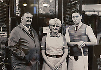 Pictured L-R: Alun and Pauline Lewis with Thomas Lewis Jones..<br /> Re: Shop owner Thomas Lewis Jones has made a Christmas advert starring Arthur Lewis Jones, his two-year-old son costing only £100.<br /> Hafod Hardware in Rhayader, Powys, has been making festive adverts for several years.<br /> This year's advert sees Arthur setting up the shop along with members of his family.