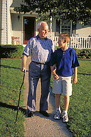 Grandfather and grandson go for a walk