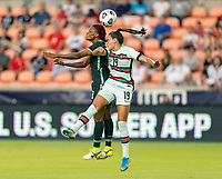HOUSTON, TX - JUNE 13: Obianujuwan Ikechukwu #18 of Nigeria goes up for a header with Diana Gomes #19 of Portugal during a game between Nigeria and Portugal at BBVA Stadium on June 13, 2021 in Houston, Texas.