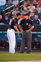 Rochester Red Wings coach Chad Allen (31) argues with home plate umpire Jansen Visconti after getting ejected in the first inning during a game against the Syracuse Chiefs on July 1, 2016 at Frontier Field in Rochester, New York.  Rochester defeated Syracuse 5-3.  (Mike Janes/Four Seam Images)