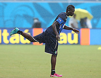 Mario Balotelli of Italy stretches during training ahead of tomorrow's Group D match vs Uruguay