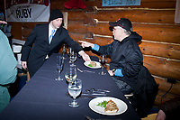 Jerod Leake of the Millenium Hotel serves one of the seven course dinner to Jeff King as the winner of the  *First to the Yukon River* award dinner inside the Community Center at the village of Ruby during the 2010 Iditarod