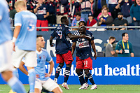 FOXBOROUGH, MA - SEPTEMBER 11: Emmanuel Boateng #11 of New England Revolution celebrates his goal with teammates during a game between New York City FC and New England Revolution at Gillette Stadium on September 11, 2021 in Foxborough, Massachusetts.