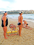 Surf life saving team in a training session at Bondi Beach in preparation of a surf carnival.