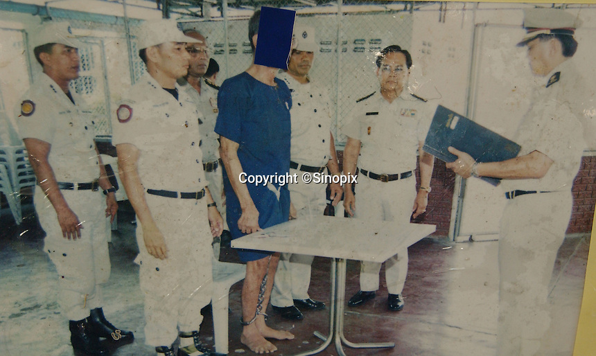A 65 year-old heroin smuggler is has his fingerprints taken in Thailand's exection chamber minutes before being shot to death. Thailand's only executioner Chawalate Jarubun of Bangkwang Central Prison has executed 55 prisoners.