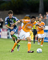 Houston Dynamo forward Brian Ching (25) holds off Seattle Sounders midfielder Brad Evans (3).  Houston Dynamo tied Seattle Sounders 1-1 on August 23, 2009 at Robertson Stadium in Houston, TX.