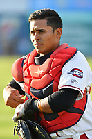 Catcher Isaias Lucena (19) of the Greenville Drive warms up prior to a game against the Lexington Legends on Wednesday, April 12, 2017, at Fluor Field at the West End in Greenville, South Carolina. Greenville won, 4-1. (Tom Priddy/Four Seam Images)