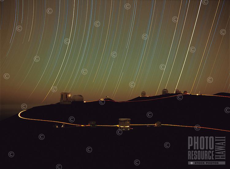 Mauna Kea Observatory at night.Star trails over Mauna Kea Observatory at night, long exposure