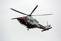 Pictured: A Coastguard helicopter approaches its landing site at Tafarn y Gerreg in Powys, Wales UK. Wednesday 29 June 2016<br />Re: Rescuers have found a number of the 24 children who went missing the Brecon Beacons.<br />Dyfed-Powys Police said a Coastguard helicopter had found some the children, who are from St Albans, Hertfordshire.<br />The helicopter has landed and the crew are with the children, but their condition is not known.<br />The alarm was raised at about 13:00 BST after the groups went missing around Llyn y Fan Fach, near Abercraf.<br />The children are in their mid teens and were on the beacons as part of their Duke of Edinburgh Award.<br />Mark Moran from Central Beacons Mountain Rescue said his team had been in intermittent phone contact with the four groups of six children before the first group were found.