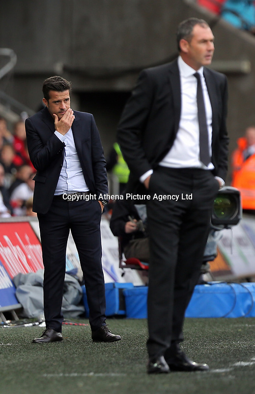 (L-R) Watford manager Marco Silva and Swansea manager Paul Clement stand on the touch lines during the Premier League match between Swansea City and Watford at The Liberty Stadium, Swansea, Wales, UK. Saturday 23 September 2017
