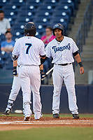 Tampa Tarpons designated hitter Timothy Robinson (30) congratulates Angel Aguilar (7) after he hit a home run in the bottom of the third inning during a game against the Daytona Tortugas on April 18, 2018 at George M. Steinbrenner Field in Tampa, Florida.  Tampa defeated Daytona 12-0.  (Mike Janes/Four Seam Images)