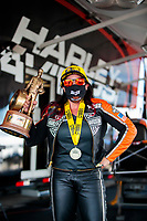 Aug 9, 2020; Clermont, Indiana, USA; NHRA pro stock motorcycle rider Angelle Sampey celebrates with the trophy after winning the Indy Nationals at Lucas Oil Raceway. Mandatory Credit: Mark J. Rebilas-USA TODAY Sports