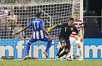 Rony Martinez of Honduras looks on as Nick Rimando #1 of the USMNT defends the goal on July 24, 2013 at Dallas Cowboys Stadium in Arlington, TX. USMNT won 3-1.