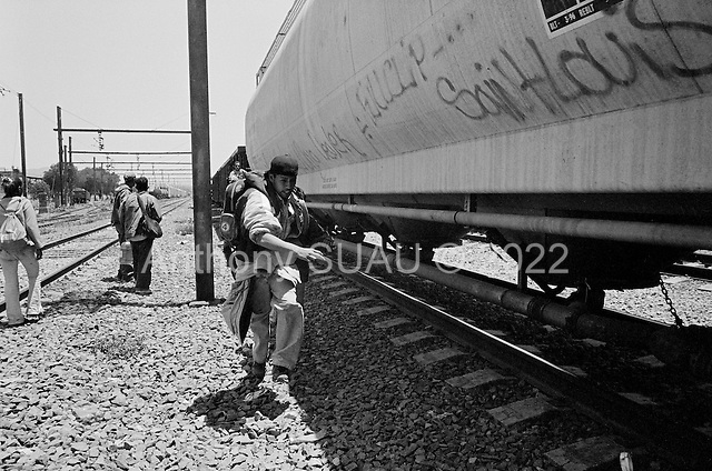 Ecatepec, Mexico<br /> Mexico<br /> June 4, 2007<br /> <br /> In the train station named Lechería , central and south Americans who had ventured north to Mexico City, mainly from Honduras, (but also from Guatemala and El Salvador),  jump the trains to take them north. Most of them had been traveling for one or two weeks. The train guards allowed them to travel and pointed out which train would take them to Monterrey where they could find a train to the USA border. Stories are abound of those killed while trying to jump the trains and police brutality.