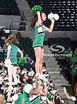 A North Texas Mean Green cheerleader in action during the NCAA Women's basketball game between the South Alabama Jaguars and the University of North Texas Mean Green at the North Texas Coliseum,the Super Pit, in Denton, Texas. South Alabama defeated UNT 79 to 61.