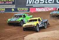 Mar. 19, 2011; Chandler, AZ, USA;  LOORRS pro two driver Rob Naughton goes inside of Nick Tyree during round one at Firebird International Raceway. Mandatory Credit: Mark J. Rebilas-US PRESSWIRE