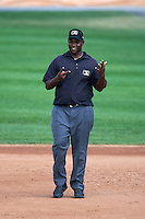 Umpire Dexter Kelley during a game between the Auburn Doubledays and Batavia Muckdogs on September 7, 2015 at Dwyer Stadium in Batavia, New York.  Batavia defeated Auburn 6-3.  (Mike Janes/Four Seam Images)