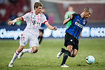 FC Internazionale Defender Joao Miranda (R) plays against Bayern Munich Forward Thomas Muller (L) during the International Champions Cup match between FC Bayern and FC Internazionale at National Stadium on July 27, 2017 in Singapore. Photo by Marcio Rodrigo Machado / Power Sport Images