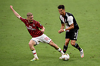 Alexis Saelemaekers of AC Milan and Cristiano Ronaldo of Juventus compete for the ball during the Serie A football match between AC Milan and Juventus FC at stadio San Siro in Milan ( Italy ), July 7th, 2020. Play resumes behind closed doors following the outbreak of the coronavirus disease. <br /> Photo Federico Tardito / Insidefoto