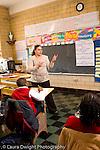 K-8 Parochial School Bronx New York Grade 4 female teacher talking to students vertical