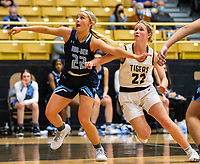 Ella Nelson (22) of Spring Har-ber and Riley Hayes (22) of Bentonville fight for rebound at Tiger Arena, Bentonville, AR January 5, 2021 / Special to NWA Democrat-Gazette/ David Beach
