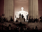 """A group of visitors to the Lincoln Memorial spontaneously hold up a sign saying, """"I Still Have a Dream."""""""