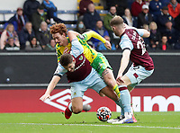 2nd October 2021;  Turf Moor, Burnley, Lancashire, England; Premier League football, Burnley versus Norwich City: Josh Sargeant of Norwich City tangles with James Tarkowski of Burnley as they compete for the ball
