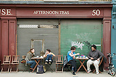 Afternoon teas in a street near Brick Lane in Whitechapel, an area of London which has become fashionable with tourists and young people in recent years