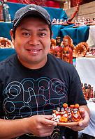 Chichicastenango, Guatemala.  Vendor Selling Nativity Scene Showing Women of the Quiche (K'iche') Ethnic Group.