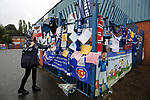 A fan reading messages of support for Bury FC outside Gigg Lane. 28/08/2019. Gigg Lane, Bury. Photo by Paul Thompson.