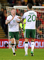 (L-R) James McClean of Ireland celebrates his goal with team mate Shane Duffy during the FIFA World Cup Qualifier Group D match between Wales and Republic of Ireland at The Cardiff City Stadium, Wales, UK. Monday 09 October 2017
