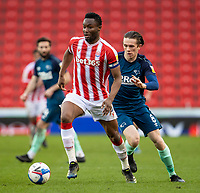 20th March 2021; Bet365 Stadium, Stoke, Staffordshire, England; English Football League Championship Football, Stoke City versus Derby County; John Obi Mikel of Stoke City under pressure from  Max Bird of Derby County